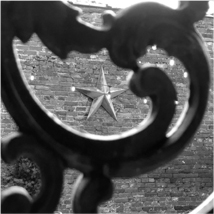 A star behind an fence ornament